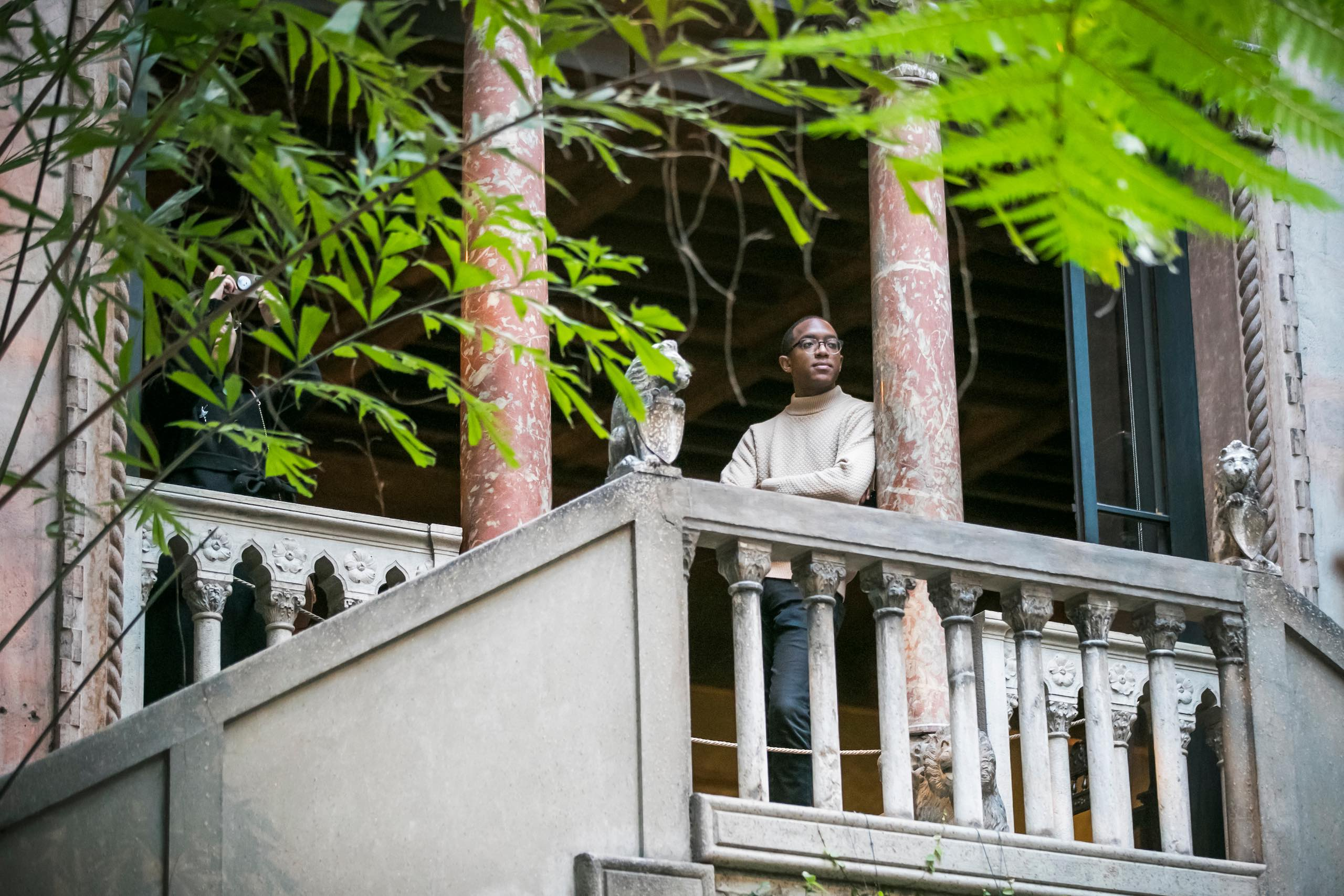 a man leaning out on a balcony