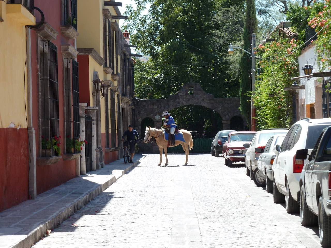 man on a horse in the street