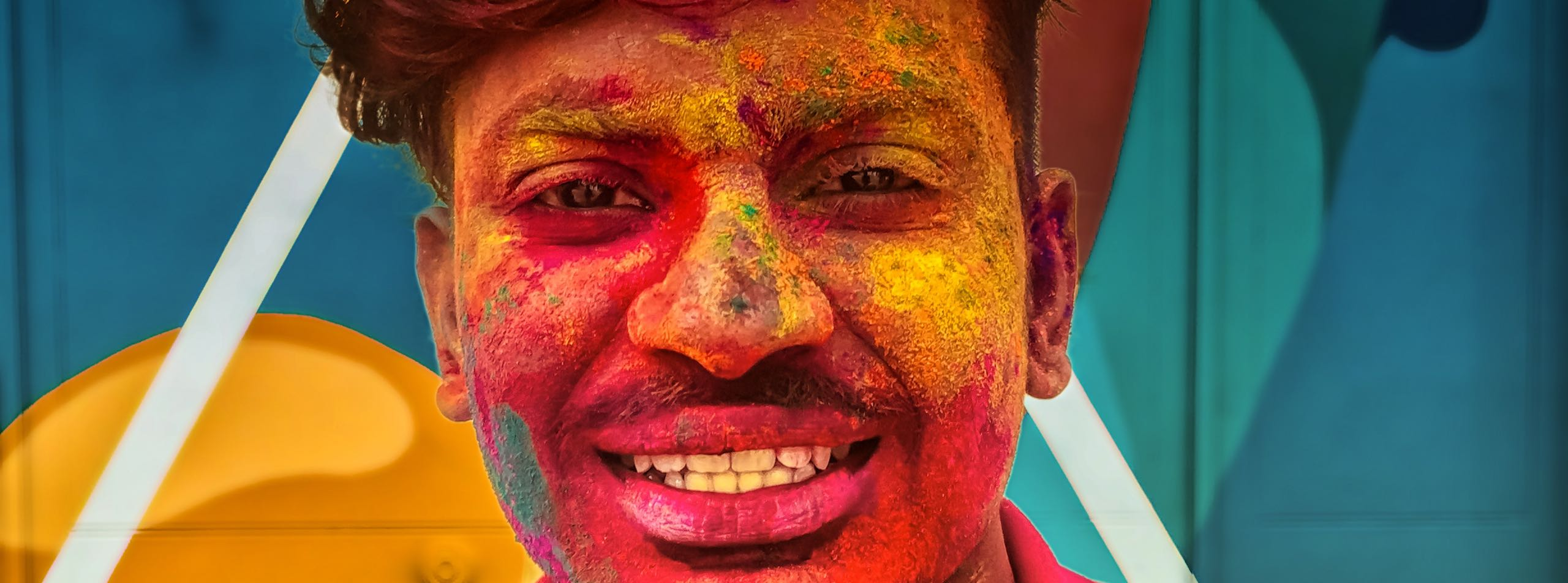Colorful face of a man during Holi